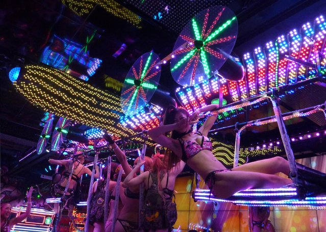 A model of a B-52 plane, carrying girls, moves through the Robot Restaurant, an adult-oriented cabaret in Tokyo's Kabukicho night entertainment district, on September 12, 2012. (Photo by Kyodo News via Getty Images)