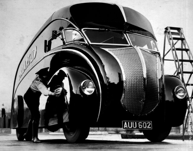 A driver polishes his new streamlined lorry upon its arrival at Wembley, London. The lorry is mounted on a 'Commer' two-ton chassis, 1933