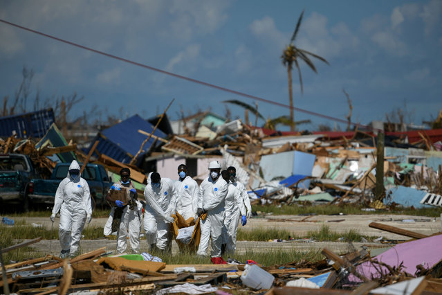 Personnel from the Royal Bahamas Police Force remove a body recovered in a destroyed neighbourhood in the wake of Hurricane Dorian in Marsh Harbour, Great Abaco, Bahamas, September 9, 2019. (Photo by Loren Elliott/Reuters)