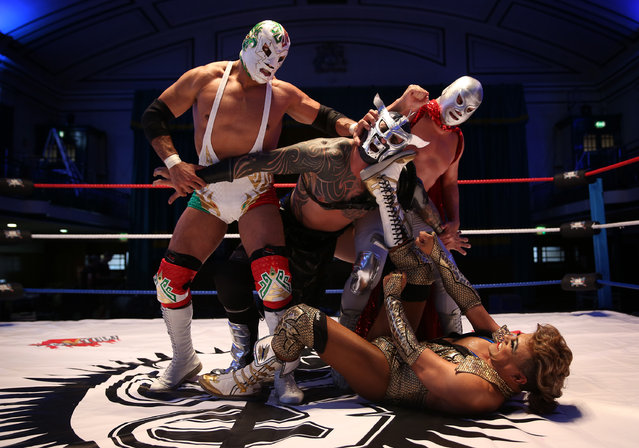 "Mexican Lucha Libre wrestlers Dr Wagner JR, Cassandro and El Hijo Del Santo pose at York Hall with Lucha Britannia's Metallico on July 8, 2015 in London, England. Lucha Libre, which translates as ""free fighting"", is a Mexican style of wrestling where fighters enter the ring in flamboyant capes and outlandish suits, performing acrobatic moves and flying from spectacular heights. The three day wrestling festival will take place at York Hall in Bethnal Green from 9th – 11th July 2015. (Photo by Peter Macdiarmid/Getty Images)"