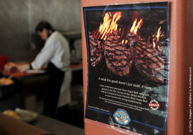 An advertisement for beef steaks is displayed at Marina Meats