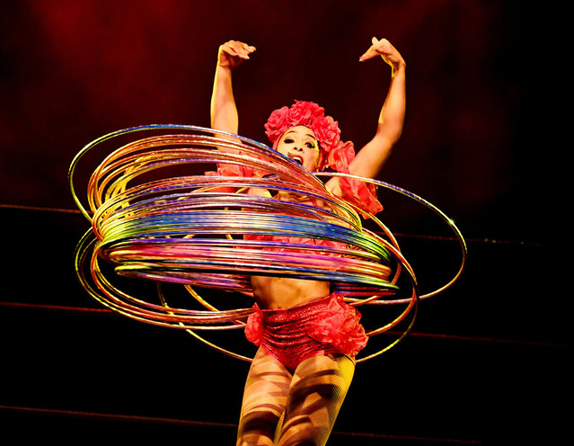 "Performer Marawa ""the Amazing"", who holds the world record for the most hoola hoops used in a performance (200), dances during a special Cinco de Mayo show by the Lucha Vavoom ensemble in Los Angeles, California on May 4, 2017. Cinco de Mayo commemorates the Mexican Army' s unexpected victory over French forces in 1862. In the US the festival is a celebration of Mexican- American culture. (Photo by Mark Ralston/AFP Photo)"