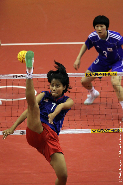Sepaktakraw: Malaysia's Noor Farhana Binti Ismail competes against South Korea during day one of the ISTAF Super Series at Palembang Sport Convention Center