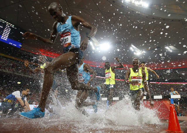 Runners compete in the men's 3000-meter steeplechase race during the 2014 IAAF World Challenge Beijing at the Bird's Nest Stadium in Beijing, China, 21 May 2014. (Photo by Rolex Dela Pena/EPA)