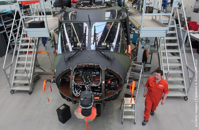 Workers assemble a Eurocopter NH90 military helicopter at the Eurocopter plant