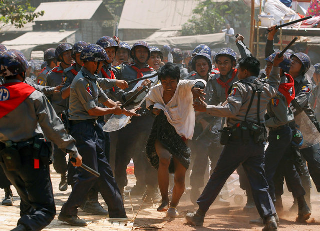 Police hit a student protester during violence in Letpadan, Myanmar, March 10, 2015. (Photo by Soe Zeya Tun/Reuters)