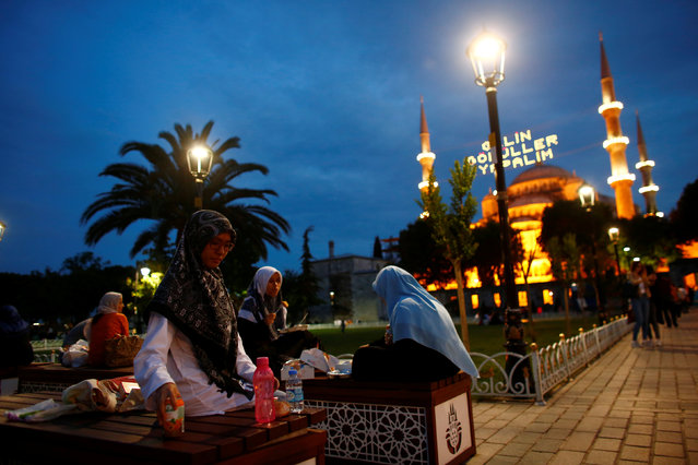 Muslims break their fast at Sultanahmet square on the first day of the holy fasting month of Ramadan in Istanbul, Turkey, June 6, 2016. (Photo by Murad Sezer/Reuters)