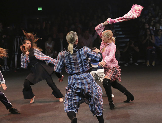 """Stunts perform at the MADE Fashion Festival """"Opening Ceremony"""" show on Friday, June 9, 2017, in Los Angeles. (Photo by Willy Sanjuan/Invision/AP Photo)"""