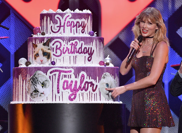 Taylor Swift poses with a giant birthday cake onstage during iHeartRadio's Z100 Jingle Ball 2019 Presented By Capital One on December 13, 2019 in New York City. (Photo by Dia Dipasupil/Getty Images for iHeartMedia)