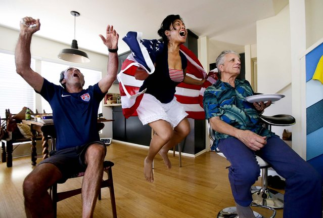 Ed Pollard, from left, Tina Termsomket and John Courte react after Portugal scored against USA during the first half while watching a televised group G World Cup soccer match during a watch party in Newport Beach, Calif., on June 22, 2014. (Photo by Chris Carlson/Associated Press)