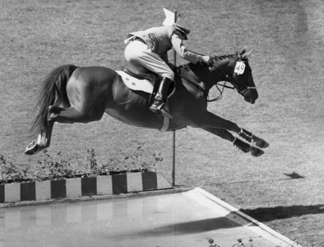 Italian Raimonde D'Inzeo, who had won a gold medal earlier in the Olympic individual show jumping, seen taking the long water jump in the team event at the Olympic stadium in Rome September 12, 1960. The competition was won by Germany, with America second and Italy third. (Photo by Allsport Hulton Archive/Getty Images)