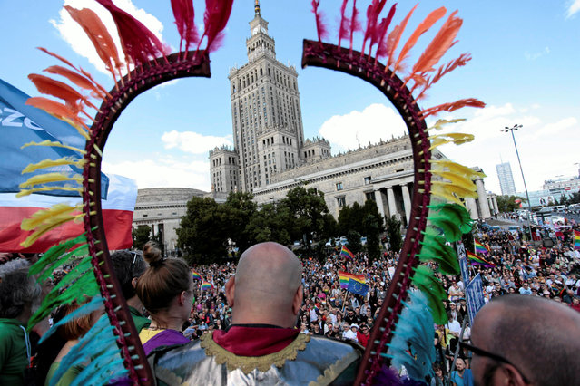 People take part in the annual Equality Parade in front of the Palace of Culture and Science in Warsaw, Poland June 11, 2016. (Photo by Dawid Zuchowicz/Reuters/Agencja Gazeta)