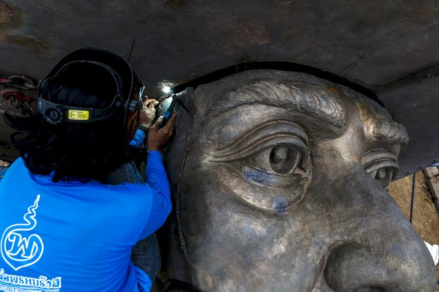 A labourer works on a giant bronze statue of former King Rama I at Ratchapakdi Park in Hua Hin, Prachuap Khiri Khan province, Thailand, August 4, 2015. (Photo by Athit Perawongmetha/Reuters)