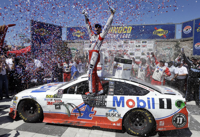 Kevin Harvick celebrates after winning the NASCAR Sprint Cup Series auto race Sunday, June 25, 2017, in Sonoma, Calif. (Photo by Ben Margot/AP Photo)