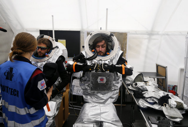 Stefan Dobrovolny of Austria and Inigo Munoz Elorza of Spain (R) prepare for a simulated Mars mission on Tyrolean glaciers in Kaunertal August 7, 2015. (Photo by Dominic Ebenbichler/Reuters)