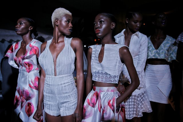 Models sit backstage during Dakar Fashion Week in the Senegalese capital, Friday June 30, 2017. (Photo by Finbarr O'Reilly/AP Photo)