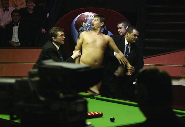 A streaker is led out of the arena during the Embassy World Snooker Final between Ronnie O'Sullivan and Graeme Dott at the Crucible Theatre on May 3, 2004 in Sheffield, England. (Photo by Gary M.Prior/Getty Images)