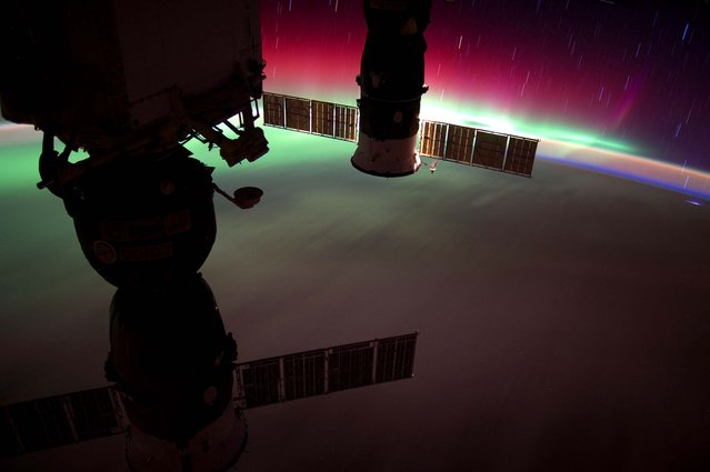This image released by NASA shows the Aurora Australis, accompanied by star streaks and air glow, recorded by one of the Expedition 31 crew members May 22, 2012 when the orbital outpost was above a point on Earth located about 290 miles southeast of southern New Zealand