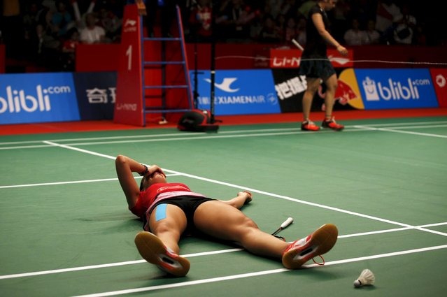 Spain's Carolina Marin reacts after winning India's Saina Nehwal after their women's finals badminton match at the BWF World Championships in Jakarta, Indonesia August 16, 2015. (Photo by Darren Whiteside/Reuters)