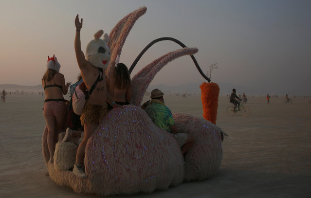 Participants ride an art car across the playa during the annual Burning Man festival in the Black Rock Desert of Nevada, U.S. on September 1, 2017. (Photo by Jim Urquhart/Reuters)