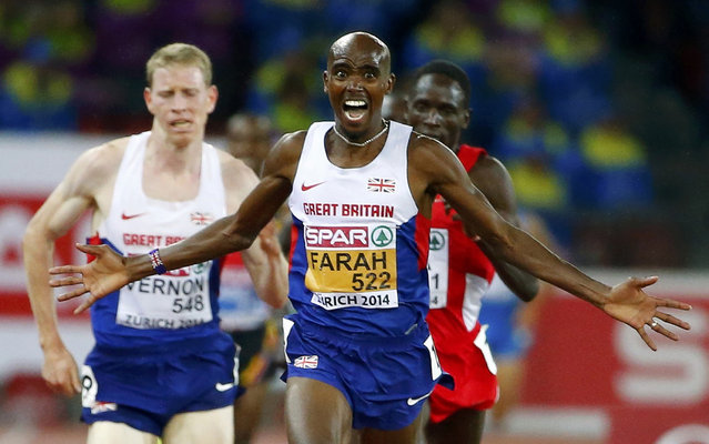 Mohamed Farah of Britain (C) celebrates winning the men's 10000 metres final during the European Athletics Championships at the Letzigrund Stadium in Zurich August 13, 2014. (Photo by Arnd Wiegmann/Reuters)
