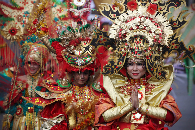 Models showcase a design on the catwalk during the eighth Jember Fashion Carnival on August 2, 2009 in Jember, East Java, Indonesia. World Unity was the theme for this year's carnival, which featured more than 400 models parading along Jember's longest street.  (Photo by Ulet Ifansasti/Getty Images)