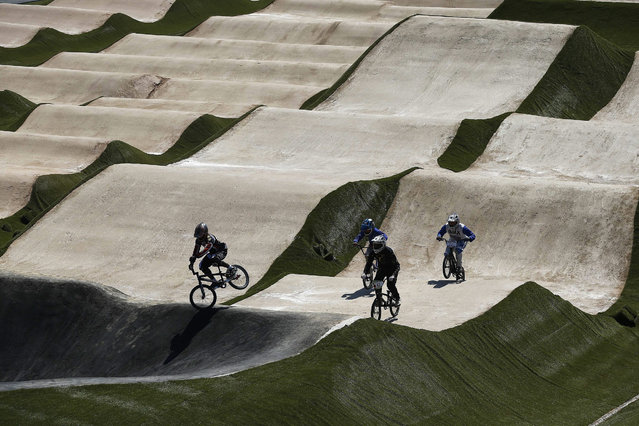 Athletes test the remodeled BMX race track, one of the main venues finished for the Olympic Games Rio 2016, presented by Rio de Janeiro Mayor, Eduardo Paes, Rio de Janeiro, Brazil, on 30 August 2015. The track is at the Deodoro sport complex, the second most important in the Brazilian city, which is the venue of eleven Olympic sports. (Photo by Marcelo Sayão/EPA)