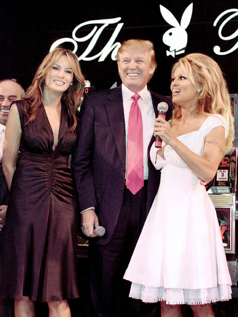 """Pamela Anderson (R) stands with Melania and Donald J. Trump, on stage, to announce the winners in his special """"Donald J. Trump Birthday Quarter Million Dollar Giiveaway"""" celebration June 11, 2005 in Atlantic City, New Jersey. (Photo by Donald Kravitz/Getty Images)"""