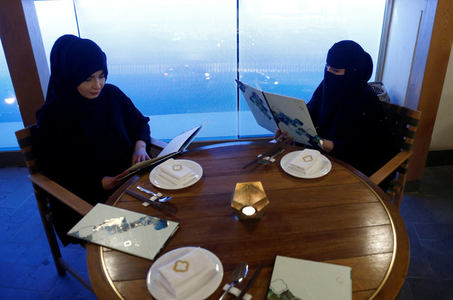 Women read menus in a cafe in Riyadh, October 6, 2016. (Photo by Faisal Al Nasser/Reuters)