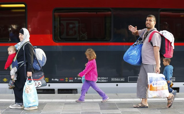 Migrants walk along a train after arriving to the main railway station in Munich, Germany September 5, 2015. (Photo by Michael Dalder/Reuters)