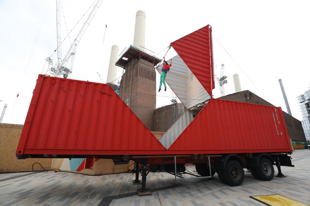 Choreographer Satchie Noro performs her work Origami in an adapted shipping container during the Dance Umbrella festival at Battersea power station n London, Wednesday, October 11, 2017. (Photo by Philip Toscano/PA Wire)