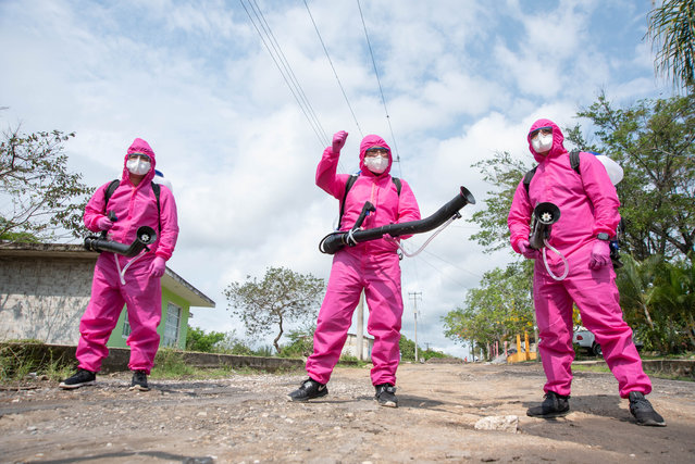 Health authority workers sanitise the rural community of Teocelo, Veracruz, Mexico on May 12, 2020 – in the hope of preventing the spread of COVID-19 infections. (Photo by Hector Adolfo Quintanar Perez/ZUMA Wire/Rex Features/Shutterstock)