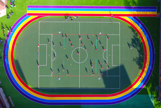 Rainbow colours on a running track at a school, Shenyang, Liaoning Province, China on October 13,  2017. (Photo by Sipa Asia/Rex Features/Shutterstock)