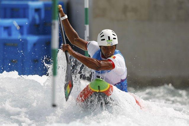2016 Rio Olympics, Canoe Slalom, Preliminary, Men's Canoe Single (C1) Heats, Whitewater Stadium, Rio de Janeiro, Brazil on August 7, 2016. Jean Bourhis (SEN) of Senegal competes. (Photo by Ivan Alvarado/Reuters)