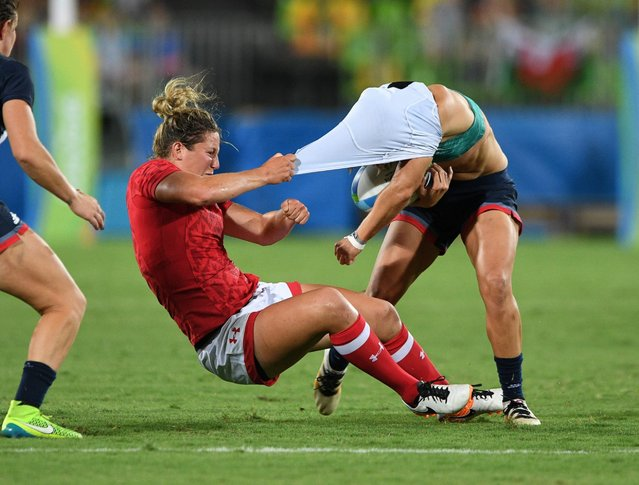 Canada's Kelly Russell rips the shirt off of Great Britain's Katy McLean as she tackles her during the bronze medal match in women's rugby sevens at the Summer Olympics in Rio de Janeiro, Brazil, Monday, August 8, 2016. (Photo by Sean Kilpatricl/Canadian Press/AP Photo)