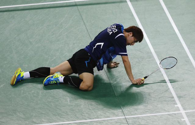 South Korea's Lee Dongkeun reacts to losing a point to China's Lin Dan during the men's team gold medal badminton match at the Gyeyang Gymnasium during the 17th Asian Games in Incheon September 23, 2014. (Photo by Olivia Harris/Reuters)