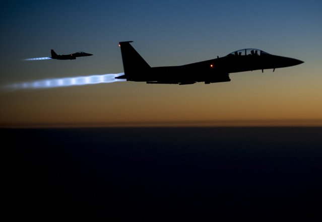 A pair of U.S. Air Force F-15E Strike Eagles fly over northern Iraq after conducting airstrikes in Syria, in this U.S. Air Force handout photo taken early in the morning of September 23, 2014. These aircraft were part of a large coalition strike package that was the first to strike ISIL targets in Syria. (Photo by Senior Airman Matthew Bruch/Reuters/U.S. Air Force)