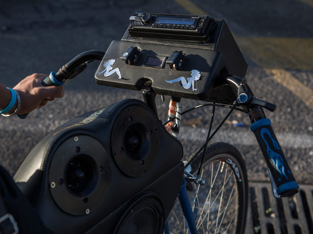 Some of the sound systems put out 1,250 watts and can shake the windows of shops and cars as the group rides past. (Photo by Matteo de Mayda/Cosimo Bizzari/The Guardian)