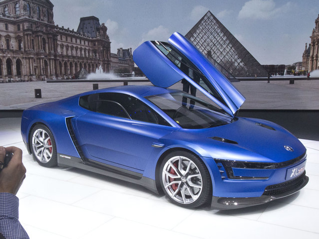 A journalist take a pictures of the Volkswagen XL Sport car during the press day at the Motor Show in Paris, France, Thursday, October 2, 2014. (Photo by Michel Euler/AP Photo)