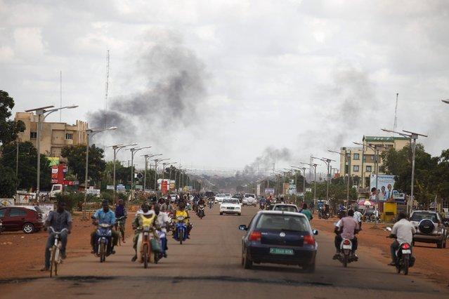 Smoke rises from burning barricades in Ouagadougou, Burkina Faso, September 19, 2015. (Photo by Joe Penney/Reuters)
