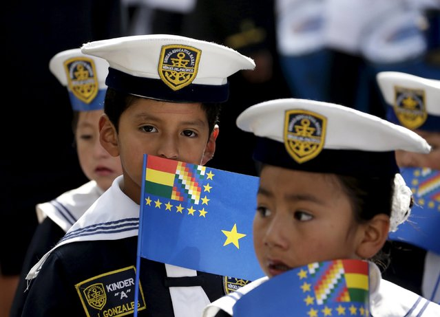 Children dressed as navy officials attend a ceremony at Murillo Square after learning the statement made by the International Court of Justice (CIJ), in La Paz, Bolivia September 24, 2015. The International Court of Justice will continue to hear a case brought by Bolivia against Chile seeking to force its neighbour to enter negotiations to grant it unfettered access to the Pacific Ocean, the court said on Thursday. (Photo by David Mercado/Reuters)