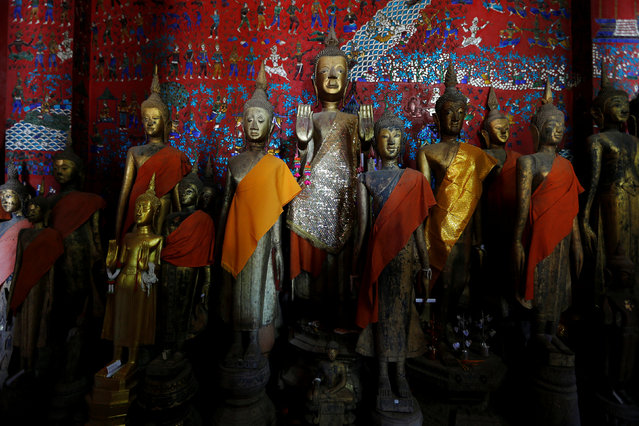 Religous figures are seen inside Wat Xieng Thong Buddhist temple in Luang Prabang, Laos August 1, 2016. (Photo by Jorge Silva/Reuters)