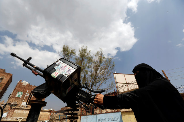 A woman loyal to the Houthi movement holds a machine gun mounted on a patrol truck as she takes part in a parade to show support to the movement in Sanaa, Yemen September 6, 2016. (Photo by Khaled Abdullah/Reuters)