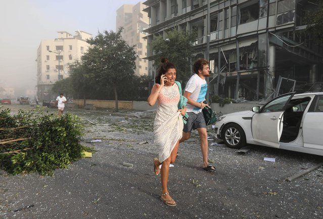 People run for cover following an explosion in Beirut's port area, Lebanon on August 4, 2020. (Photo by Mohamed Azakir/Reuters)
