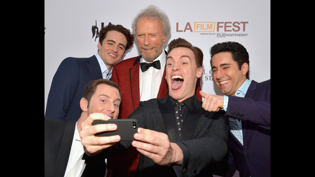 "(L-R) Actors Michael Lomenda, Vincent Piazza, director/producer Clint Eastwood and actors Erich Bergen and John Lloyd Young take a selfie at the premiere of Warner Bros. Pictures' ""Jersey Boys"" during the 2014 Los Angeles Film Festival at Regal Cinemas L.A. Live on June 19, 2014 in Los Angeles, California.  (Photo by Lester Cohen/Getty Images)"