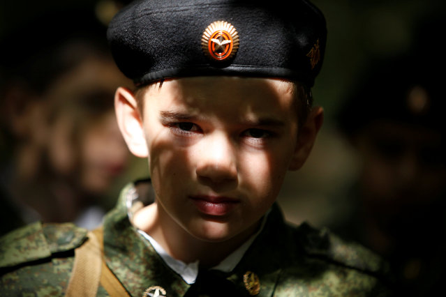 A fifth-grade student of the General Yermolov Cadet School takes part in his first military tactical exercise on the ground, which includes radiation resistance classes, forest survival studies and other activities, in Stavropol, Russia, September 10, 2016. Picture taken September 10, 2016. (Photo by Eduard Korniyenko/Reuters)