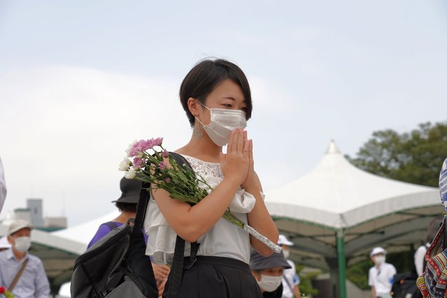 A woman prays while wearing a face mask at the Hiroshima Peace Memorial Ceremony on August 6, 2020. Hiroshima marks the 75th anniversary of the U.S. atomic bombing which killed about 150,000 people and destroyed the entire city during World War II. (Photo by Jinhee Lee/SOPA Images/Rex Features/Shutterstock)