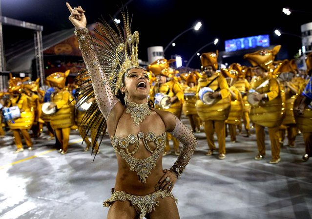 A dancer in costume from the Academicos do Tatuape samba school performs in Sao Paulo. (Photo by Andre Penner/Associated Press)