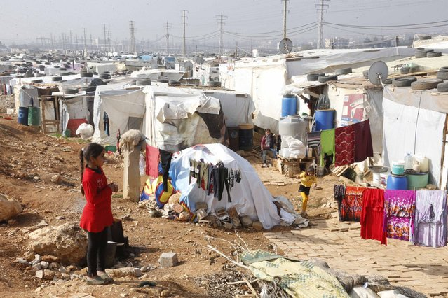 Syrian refugees are seen at a refugee camp in Zahle in the Bekaa valley November 18, 2014. (Photo by Mohamed Azakir/Reuters)