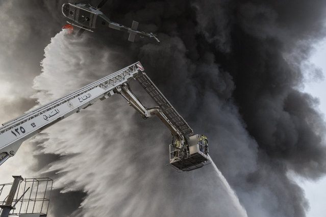 Firefighters respond to a huge blaze at Beirut port on September 10, 2020 in Beirut, Lebanon. The fire broke out in a structure in the city's heavily damaged port facility, the site of last month's explosion that killed more than 190 people. (Photo by Sam Tarling/Getty Images)